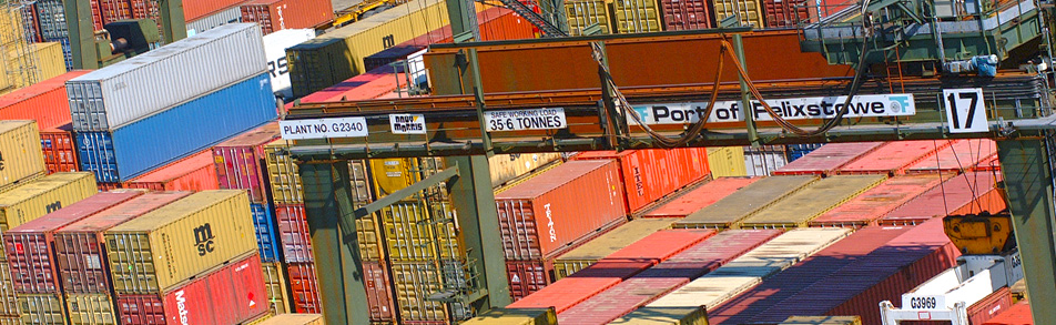 Containers stacked under a crane