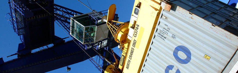 International shipping container being lifted with a gantry crane