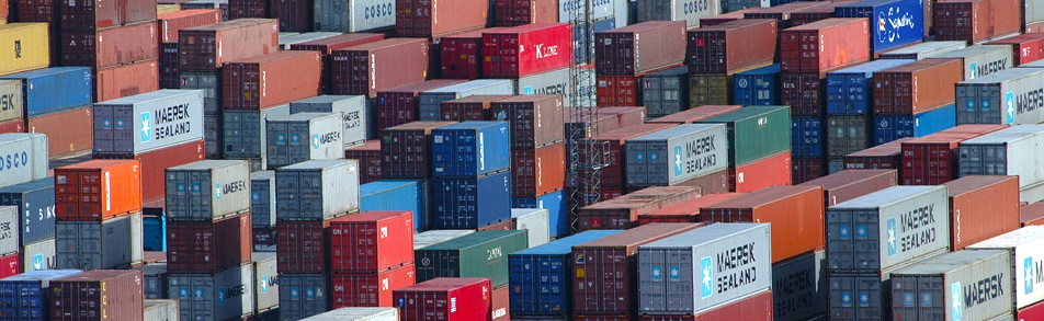 Stacks of international freight containers on a port quay