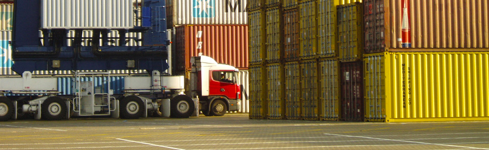 Haulage unit surrounded by containers